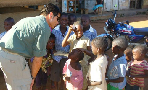 Mykel Hawke with village children in Uganda