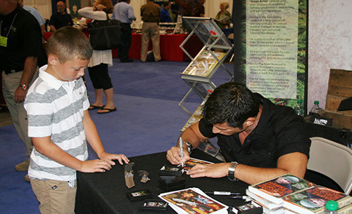 Mykel Hawke autographing books